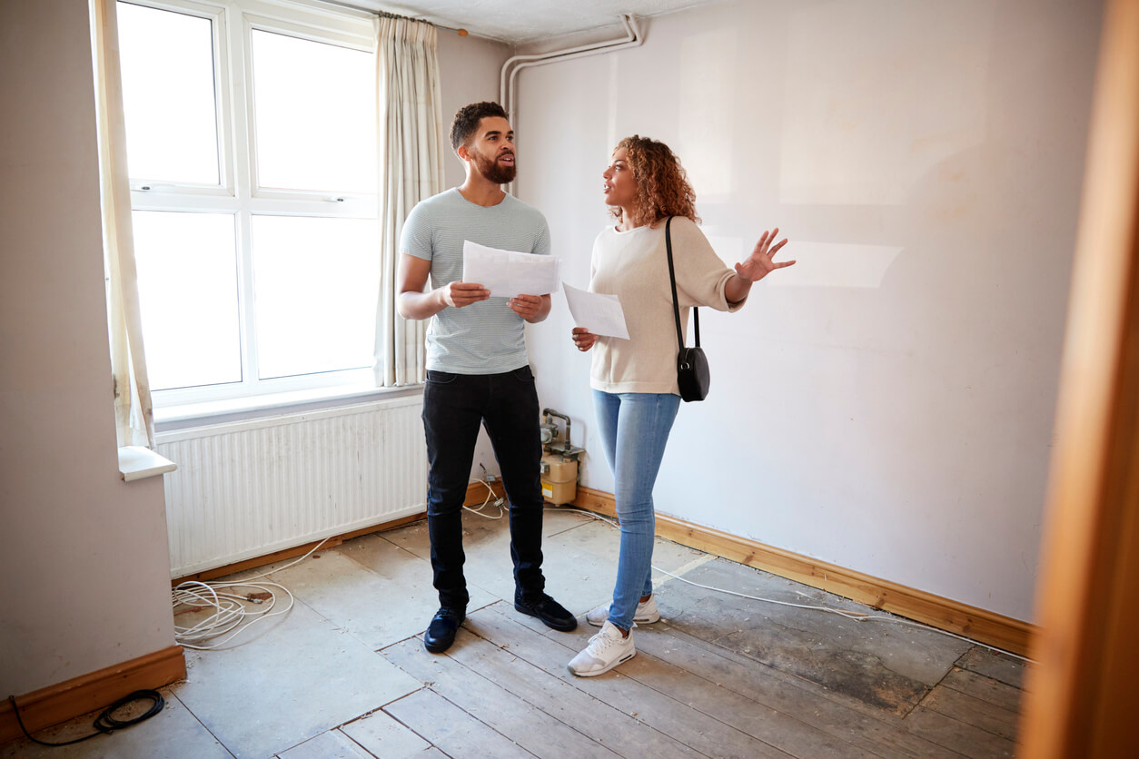 couple looking at house to buy, buying real estate concept
