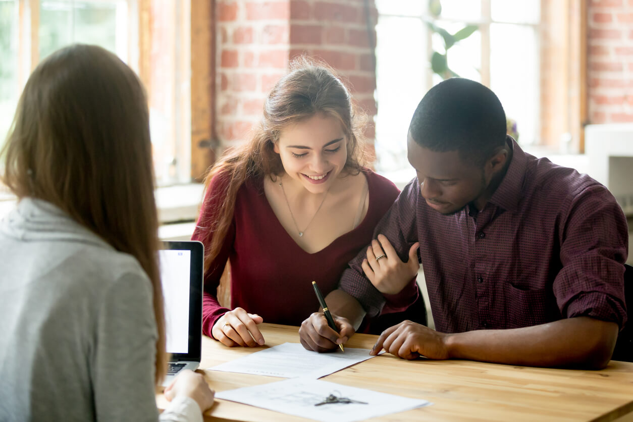 Young couple meeting with agent and refinancing their mortgage