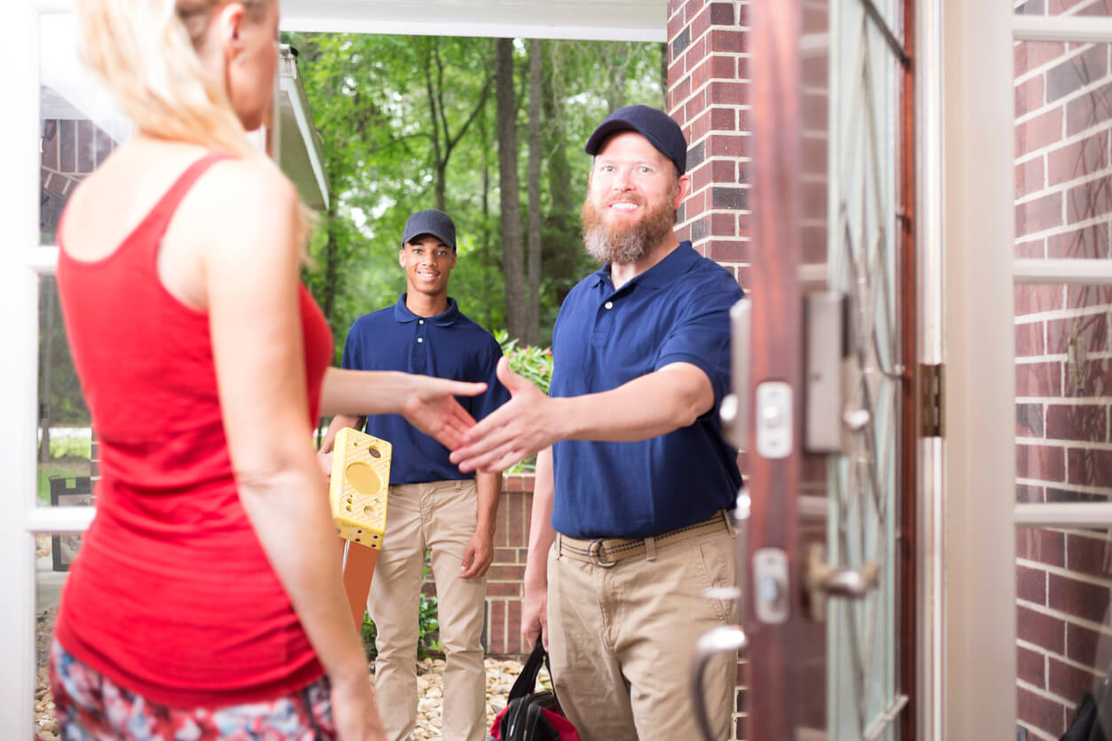 Workers arriving at a house for a home inspection