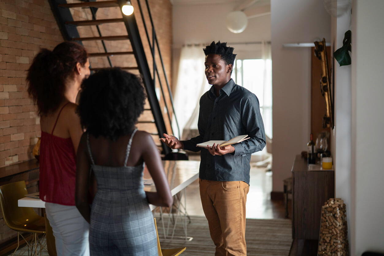 Two women touring homes with a real estate agent