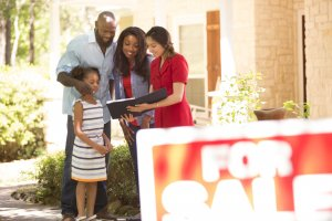 Happy family buying a new house, owning a home concept