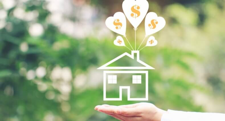A hand held out flat with the palm up and an illustration of a house with heart-shaped balloons with dollar signs coming out of the chimney