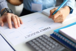 Two people creating a budget for new house   SIGNATURE PROPERTIES GROUP